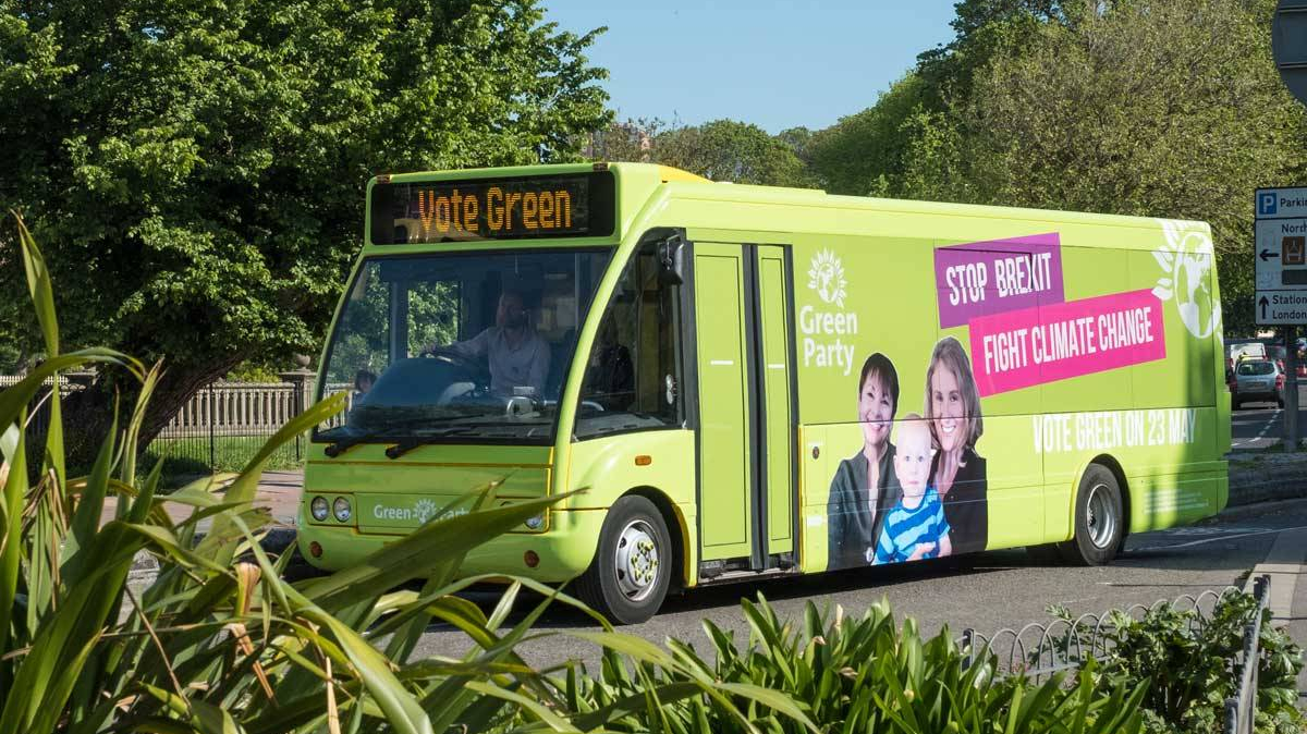 Green party brings its battle bus – electric of course – to town