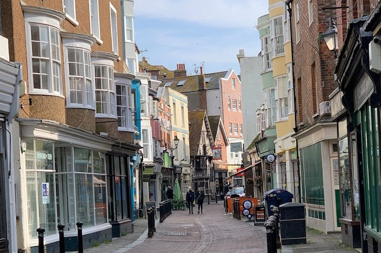 Business is brisk but council branded 'a hinderance' as the old town wakes up after enforced Covid hibernation