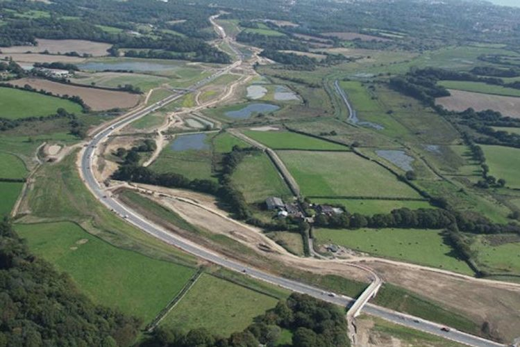 Build houses on land near the link road to deliver affordable homes say MPs