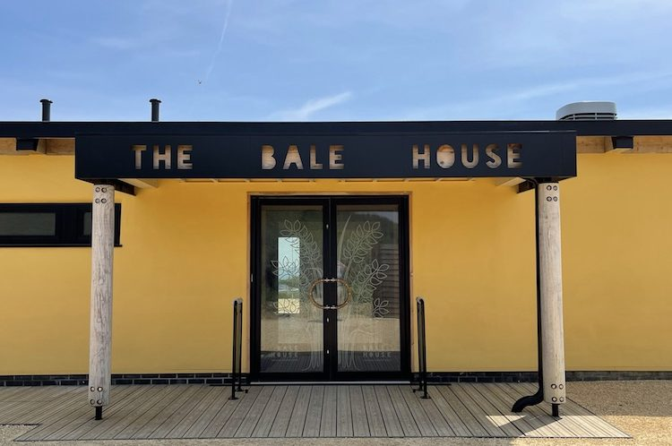 Seven years to build and three times the original cost – The Bale House WILL open this summer